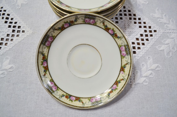 Like this item? & Vintage Victoria China Saucer Set of 7 Floral Pattern