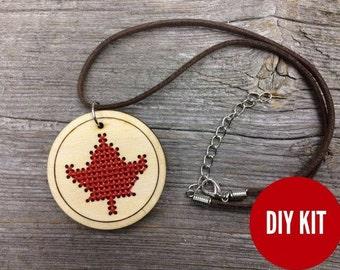 Cross stitch necklace medallion kit - DIY laser cut wood maple leaf pendant for Canada 150 by Canadian Stitchery