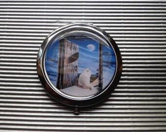 Cat Pocket mirror: the door of the sea