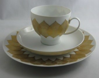 Rosenthal Germany. Porcelain coffee place setting, 3 pieces. Lotus gold leaf: white with gold accents. Bjorn Wiinblad. 1970s / 80s. VINTAGE