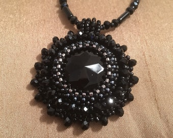Black bead embroidery pendant necklace with crystals.
