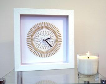 Lunar Eclipse. Gold hand cut paper clock