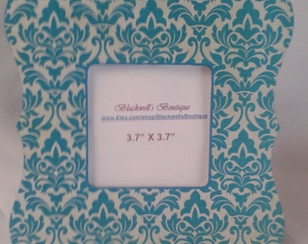 Blue and white damask picture frame. Square picture frame with scalloped edges.