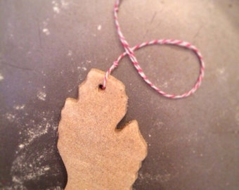 Made with Michigan sand, heart in any city. Handmade ornament/magnet that capture your heart