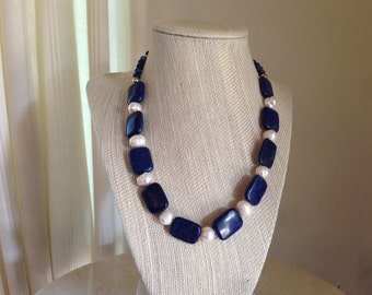 """18"""" necklace w/rectangle pieces of Lapis Lazuli interspersed with 9mm sized fresh water pearls.  Accented with gold plated beads and clasp."""