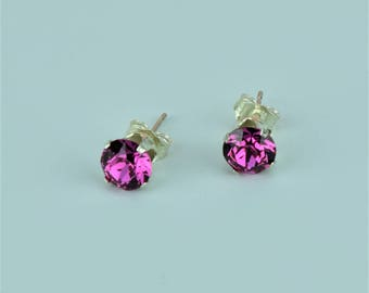Swarovski fuchsia crystal sterling silver earstuds.Rich fuchsia colour.Matching necklace available too .