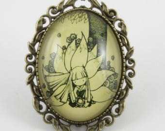 """The legend of Kaguya"" pattern glass cabochon brooch 40 x 30 mm"
