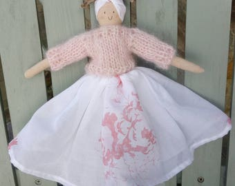 Handmade doll with a cabbages and roses pink hatley skirt