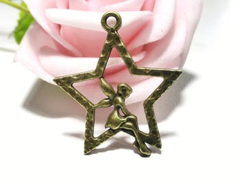 10 charms bronze fairy sitting on the metal star
