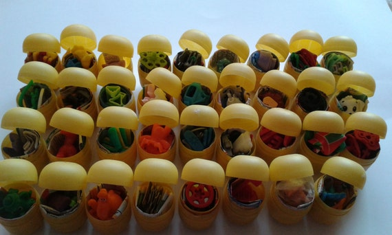 35 different KINDER SURPRISE TOYS shells,no chocolate New unbuilt from the eggs