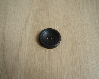 Black hollow round shape button