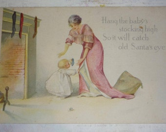 Mother, Baby, Stocking and Fireplace Antique Christmas Postcard