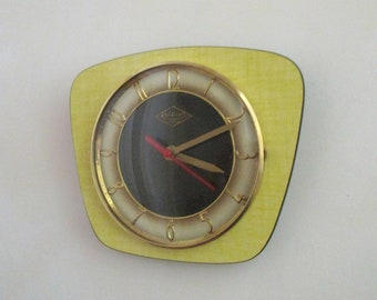 French 1950-60s Atomic Age LUTETIA - Yellow and Black Formica Wall Clock - Freeform Shape - Good Working Condition