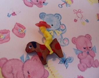 tiny cowboy on a tiny animal