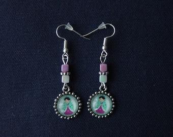 Light green and fuchsia background light turquoise blue matryoshka earrings