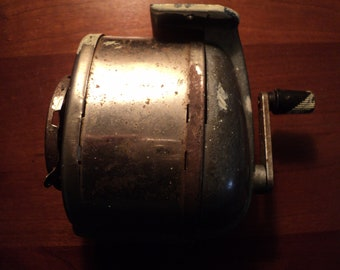 Vintage shabby old working school type wall hung manual pencil sharpener