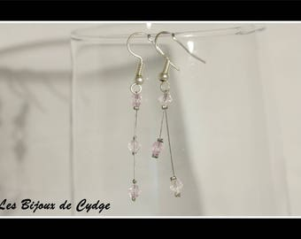 Earrings on twisted wire and its very light purple bicone bead