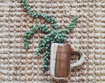 Small pottery mug