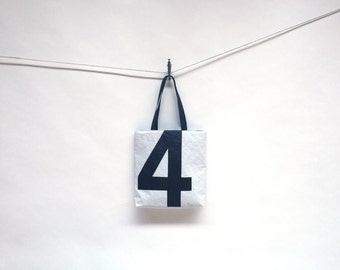 Sail Bag Handmade From Recycled Sailboat Sails Featuring A Black Number 4