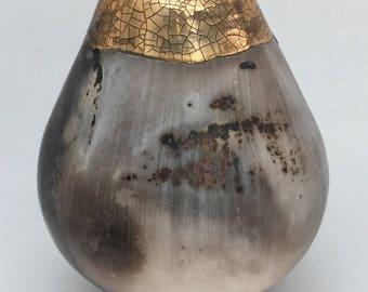 Smokefired ceramic pot with gold. Porcelain burnished vessel.