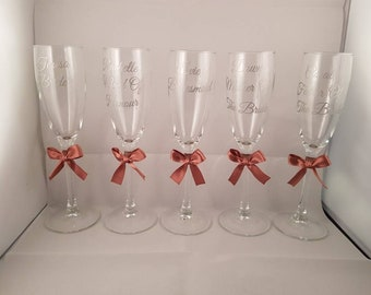 personalised Champagne flutes with a pretty bow for you and your bridal party