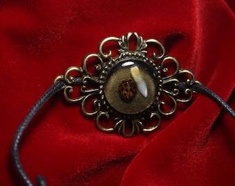 Ladybug/Tooth Bracelet.