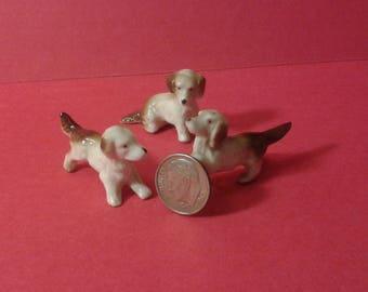 Three ceramic dogs
