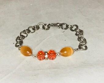 Chainmail inspired orange beaded linked bracelet