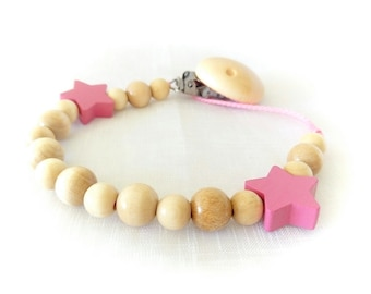 Soother, pacifier varnished natural wood beads and dark pink stars