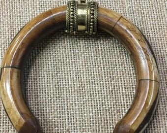 Yak bone crescent pendant