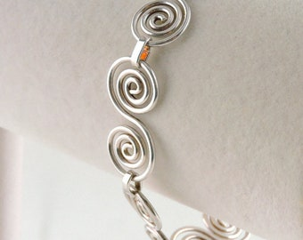 "Sterling Silver Swirl Link Toggle Bracelet 8"" (14.5 grams)"