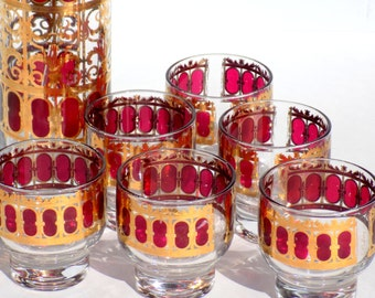 Mid Century Bar Set Culver Cranberry Scroll Cocktail Pitcher and Six Footed Punch Cups