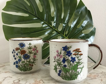Pair of Vintage 1960s White Speckled Mugs with Floral Design - Made in Japan