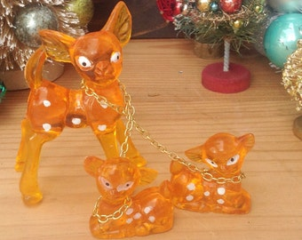 Vintage orange deer trio.  Mommy deer chained to 2 baby deer. Vintage deer. Christmas decor. Holiday decor. Kitschy.  Kitschy Christmas.