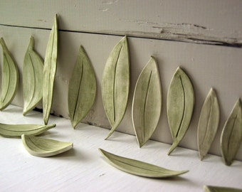 Eighteen Ceramic Leaves.   Fired Clay Leaves.  Hand-Built Foliage For Table, Windowsill, Bookshelf.