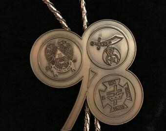 Large vintage Shriner's bolo tie//antiqued brass bolo tie//gold cord bolo tie//bolo tie for men