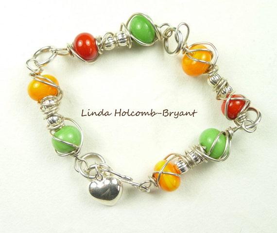 SALE Silver Bracelet of Green, Orange & Red Lampwork Beads