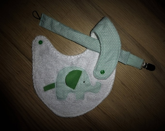 Bib and a pacifier clip