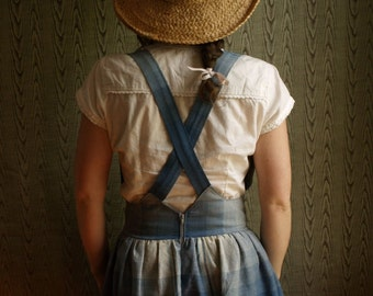Gathered pinafore skirt with wooden buttons and hidden pockets.cotton chambray. made to measure