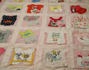 Adorable baby clothes keepsake quilt
