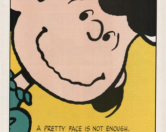 "1989 Metropolitan Life Insurance Company Lucy Peanuts ""A Pretty Face Is Not Enough"" Vintage Color Art Print Ad"