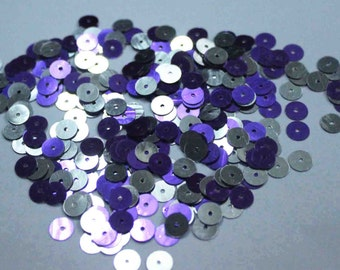 100 Round Blue and Silver Sequins.....one side Purple and the other side Silver/KBRS116