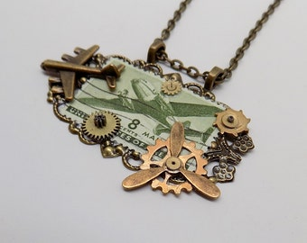 Steampunk pendant. Stamp jewelry. Stamp pendant.