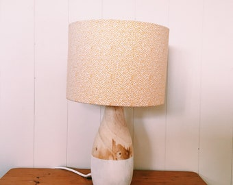 Wood base lamp with yellow/ orange and white pattern shade
