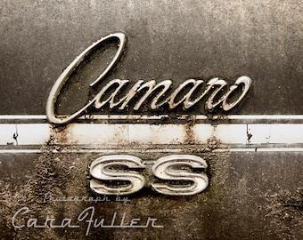 Camaro SS Emblem on Black Car Photograph