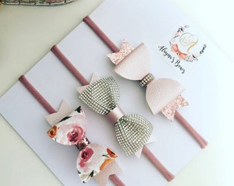 Blush floral diamonte bow set on clips or headbands