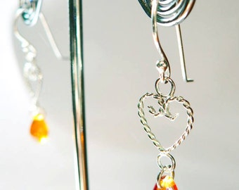Sterling silver filigree earrings, with a cognac-coloured glass bead