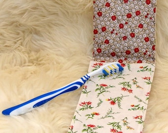 Dress handkerchief with red flowered toothbrush with floral oilcloth inside