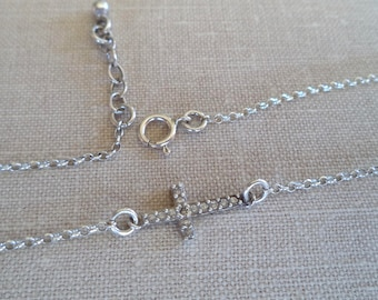Delicate cross sterling silver chain bracelet