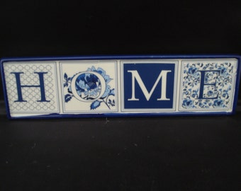 A Blue/White Home Sign/ tile/ Plaque
